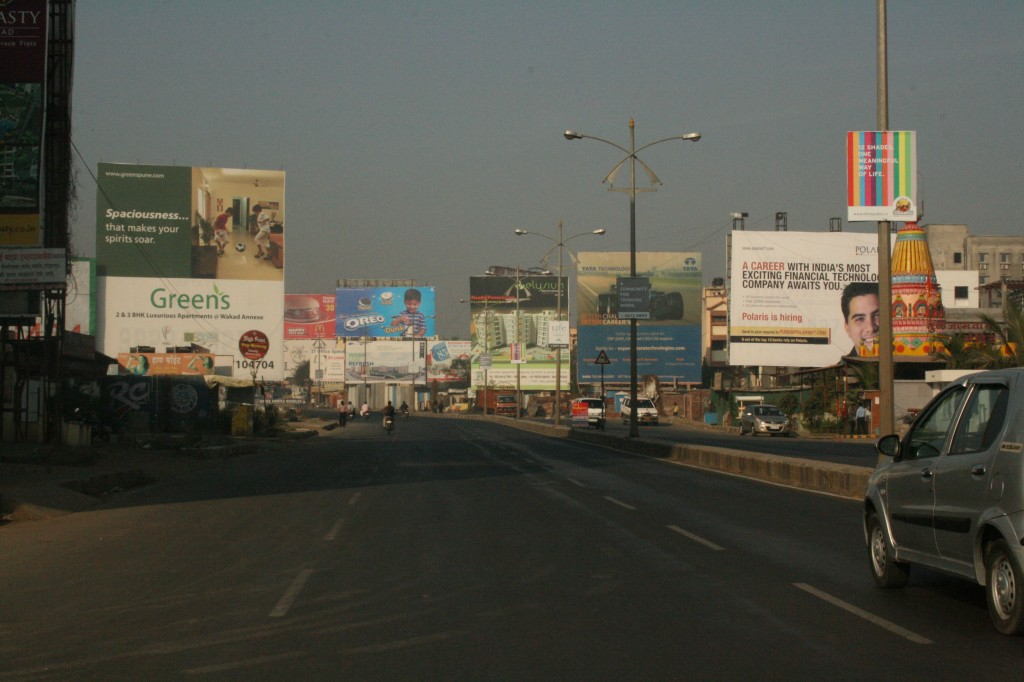 pune, billboards over billboards for products 90% of the people here can't afford nor need