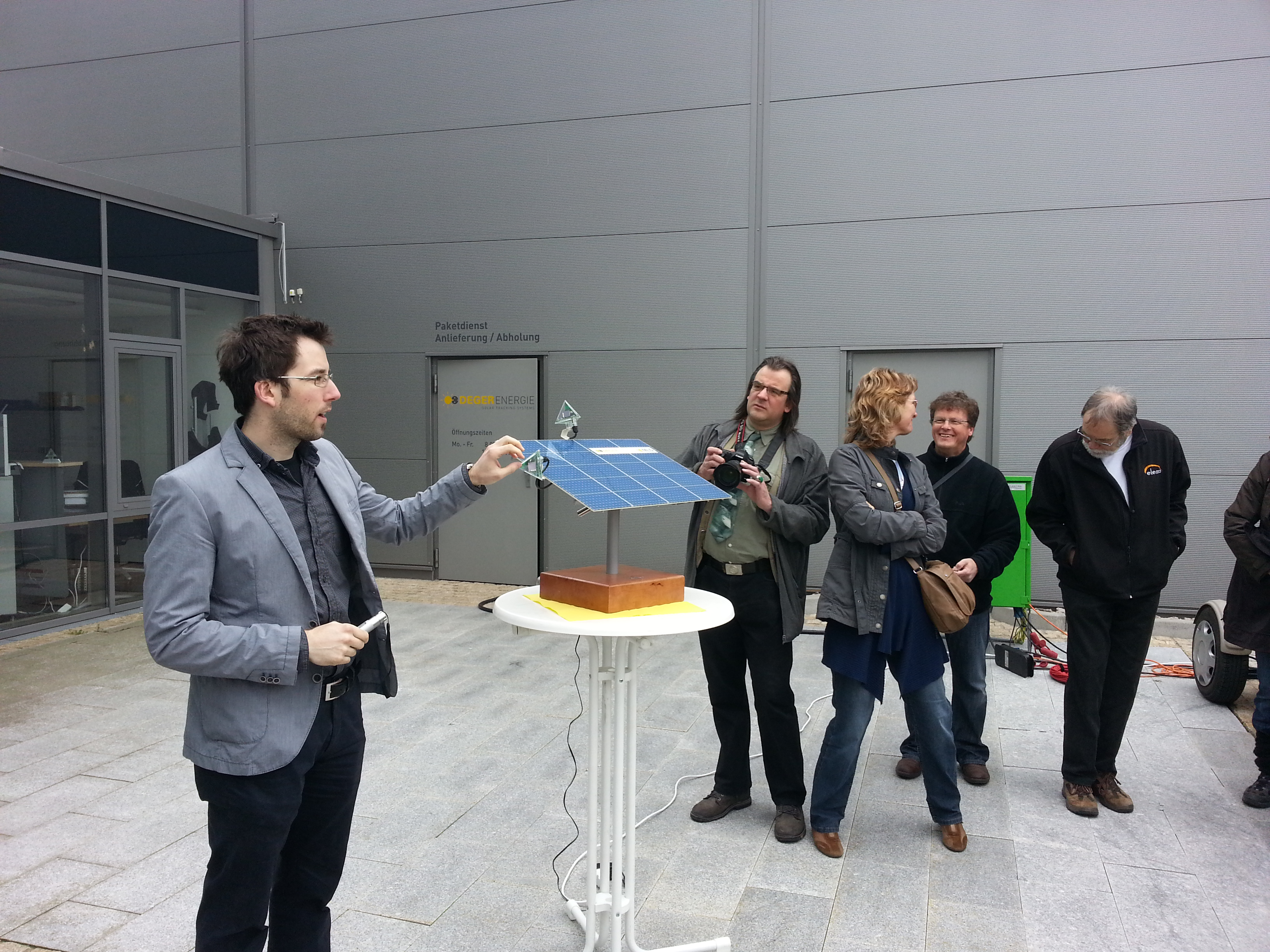 a deger energie representative explaining tracker technology