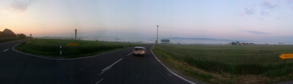 descending into morning fog - central germany - pano