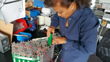 Jane changing cells on TW560's battery pack