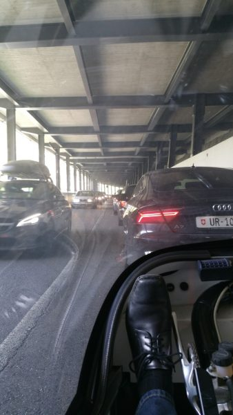 Lots of cars trying to avoid the traffic jam on the motorway