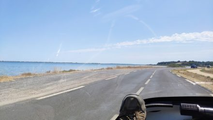Driving along the sea with a TWIKE - one of the nicest forms of mobility