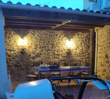 Breakfast in the courtyard with a TWIKE in view