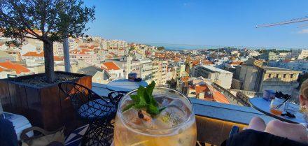 Enjoying a Portonic above Lisbons rooftops
