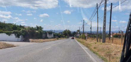 Driving down to Trafaria, Lisbon's hills in the background