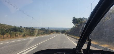 Coasting down Portugal's last hill towards Spain - my next hills in the distance